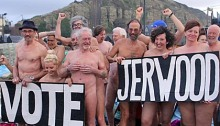 PICTURE BY CIARAN McCRICKARD/CONNORS 17/01/2014 - PEOPLE STRIP OFF ON HASTINGS BEACH BY THE JERWOOD ART GALLERY AS PART OF A FLASHING FLASH MOB TO ENCOURAGE VOTING FOR A COMPETITION TO GET PHOTOGRAPHER SPENCER TUNICK TO CREATE AN IMAGE IN THE TOWN.